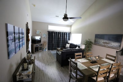 Spacious living space with vaulted ceiling and 70 inch remote controlled fan
