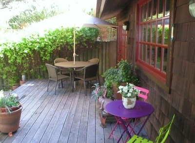 Main House front deck, BBQ, enjoy views of the yard, watch for deer and quail