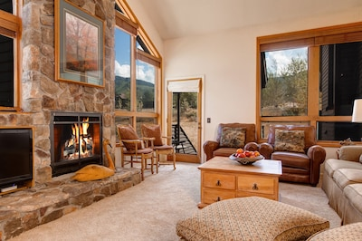 Great room, 17 Foot rock fireplace, mountain views. Large TV now above fireplace