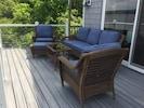 New deck furniture overlooking lake.