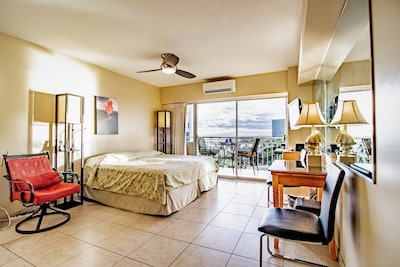 Large interior with King size bed with built in A/C & ceiling fan