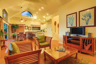 The living and dining areas and kitchen are laid out great room-style.