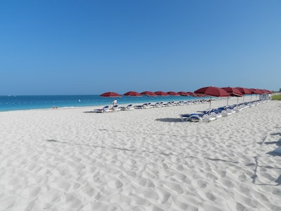 Complimentary chairs and umbrellas at our beach