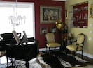 Entertain your guest with a Baby Grand player piano