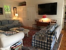 Living Rm off  kitchen and dining area  plenty of seating with 65 inch HD TV