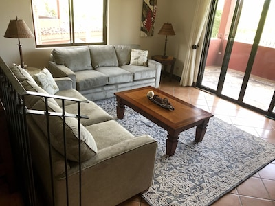 Plenty of comfortable seating in the bright and spacious living room.