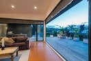 Bi fold doors open to decks