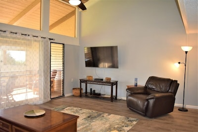Open floor plan with cathedral ceiling