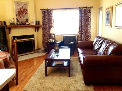 Living room with flat screen TV and electric Fireplace.. Mountain view