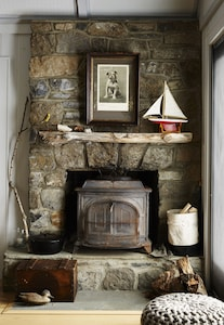 Wood burning stove in the Main Cottage living room