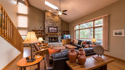Very large and inviting living room space with loads of windows with views!