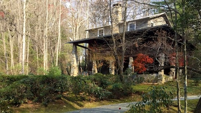 Beautiful mountain home surrounded by two gentle streams on 26 wooded acres