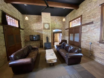 relax, watch tv and at night pull down the 2 antique Murphy beds to sleep