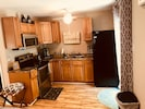 Kitchen with Stove, Micro, Toaster, Coffee and Full size Refrigerator!