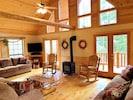 Great Room opens to deck overlooking river