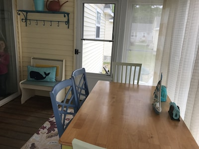 Great eating area on the enclosed porch