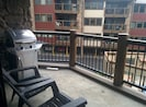 Balcony with gas grill, overlooks hot tubs, courtyard, and town.