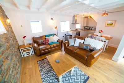 Beautiful open plan living area featuring a stunning welsh slate wall.