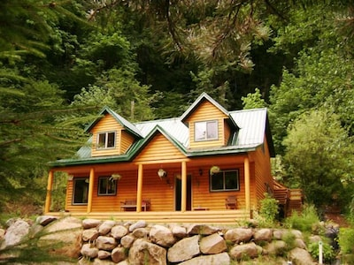 Set into a hillside surrounded by green.