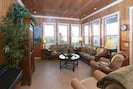 A view of Abaco Palms' living area with digital piano, 2 recliners - VIEW