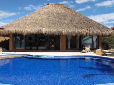 house and pool facing ocean