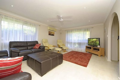 Large lounge room with seating for 9 people incl. TV and DVD plus Optus Fetch .