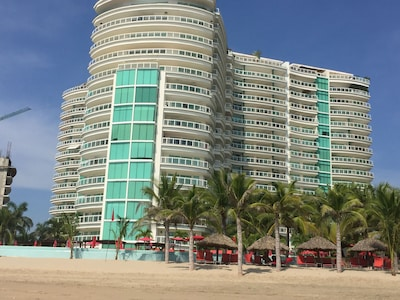 From beach, looking at building, right side, 8th floor where the shade is.