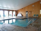 Indoor pool with a Jacuzzi in the far corner. Sauna is also in the same location