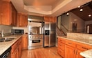 Kitchen with granite throughout & SS appliances.  Top of the line cookware.