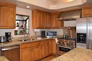 Fully stocked kitchen with coffee maker, toaster, microwave, spices, cookware