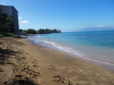 The warm water & gentle surf at the beach right in front of our 5th floor place.