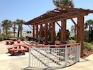 Outdoor barbecue grills and picnic tables.