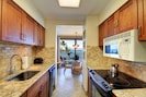 NEWLY REMODELED KITCHEN WITH GRANITE COUNTERTOPS