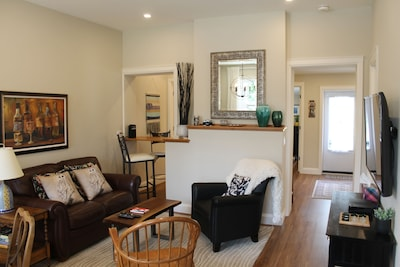 The living room with a view to the back door and kitchen
