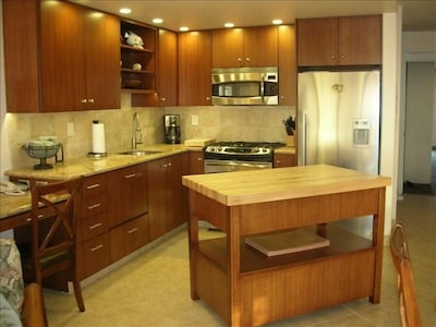 All new cabinets, granite countertop and free standing island