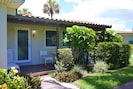 Front door enters villa via porch