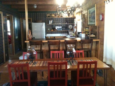 Dining with kitchen in background