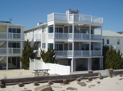 View of home from the beach. Elevated mid level is the living unit.