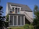 Retractable porch screens assure outdoor comfort at all times.