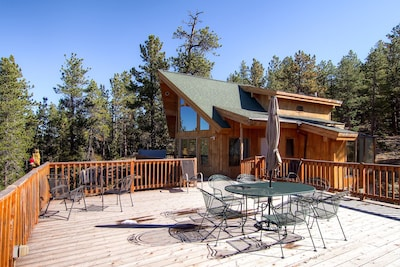 Huge views from inside or outside on massive deck with outdoor hot tub.