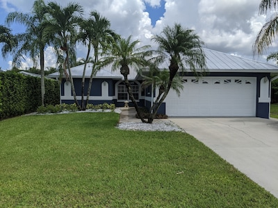Front view - Florida style.  2 car garage and plenty of parking
