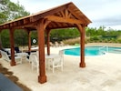 Pool pavilion for relaxing and dining in comfort.