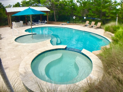 Large hot tub and shallow sunshelf.  Pool ranges from 3 feet to 5 feet deep.