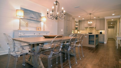 Open concept kitchen and dining area with ample seating for eight.