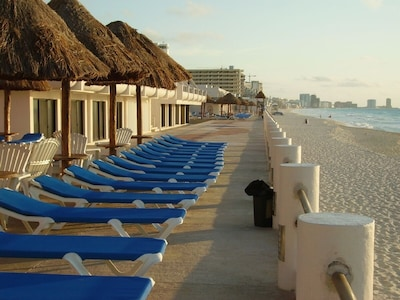 3 ocean front pools w lounge chairs palapas