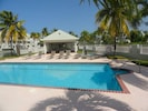 Community pool, lounge chairs and shady gazebo available for guests