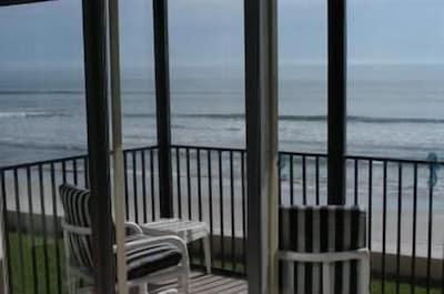 Breathtaking ocean, beach and sunrise views from condo screened-in balcony.
