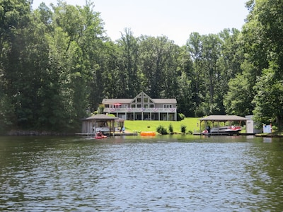 Boat house on left with launch on right side of dock.