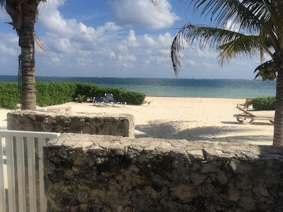 Looking out from the pool area to the private beach area and ocean beyond
