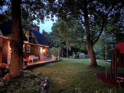 Exterior of cozy coach house deck and back yard.
